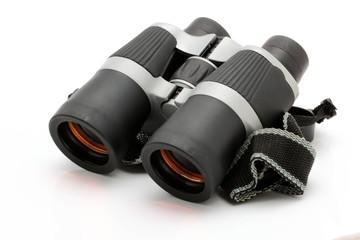 Black binoculars with orange lens isolated on white background