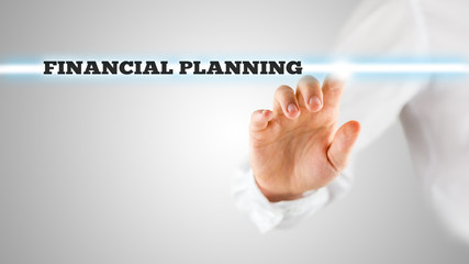 Finger Highlighting Financial Planning Words