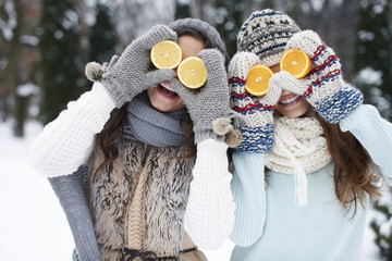 Funny girls with natural vitamins in winter