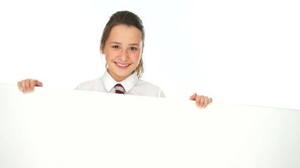 Smiling young girl holding a blank white banner