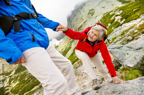 canvas print picture Senior couple hiking