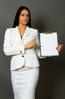 businesswoman holding a pen