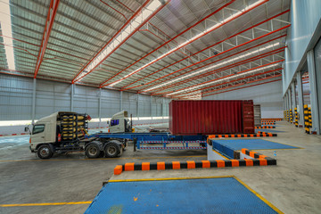 trucks at loading dock shipping industry warehouse