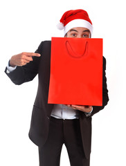 funny man in Santa hat holding red shopping bag