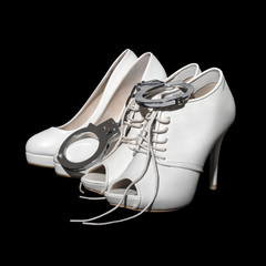 Woman white high heels with handcuffs