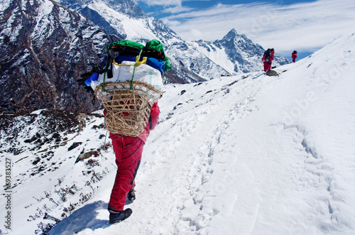 Fotobehang Nepal Porters with heavy load, Nepal