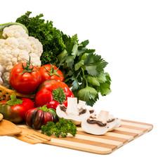 Set of vegetables in a basket .