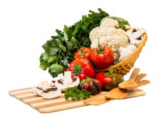 Set fresh vegetables in a basket.
