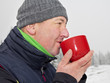Man warms up a hot drink in the cup