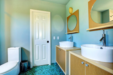 Bathroom vanity cabinets with vessel sinks and round mirrors