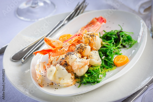 Prepared lobster on plate - 69386123