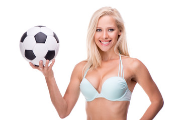 Smiling woman with soccer ball