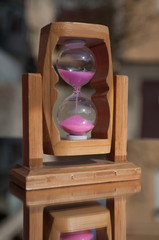 closeup of hourglass on a mirror