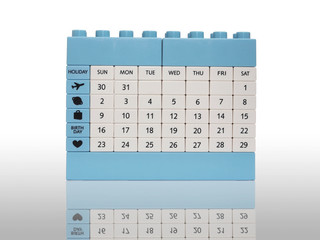Calendar brick toy isolation on white with shadow
