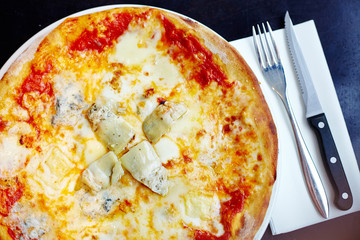 Stone baked pizza margherita with artichoke top view