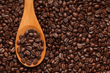 Coffee beans in a wooden spoon
