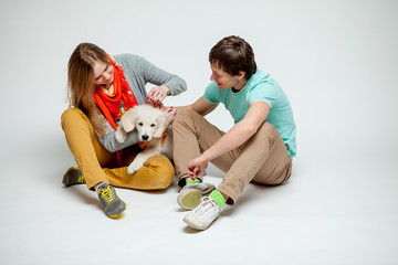couple playing with a dog