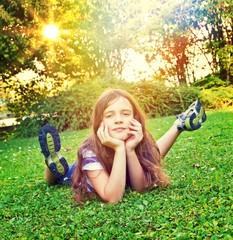 Little girl lying in grass
