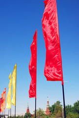 Red and yellow flags. Blue sky background. Moscow Kremlin.