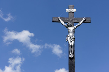 Jesus on the cross against a blue sky
