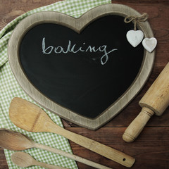 blackboard and baking items and flour on a wooden surface in rus