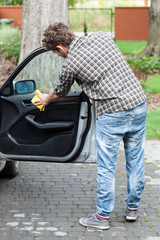 Man polishing car's door