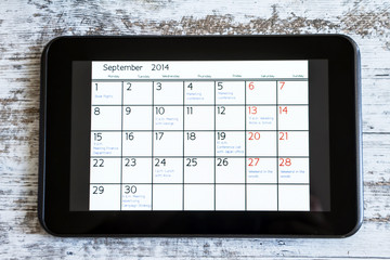Checking monthly activities in the calendar in the tablet