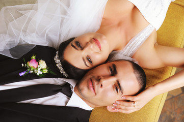 Wedding. Just Married. Lying on the couch