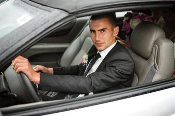 Attractive man in a car.