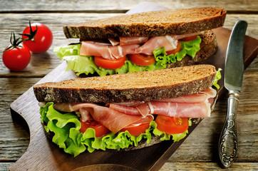 sandwich with rye bread and prosciutto