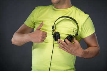 DJ holding his headphones