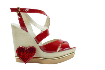 A pair of red women's sandals on a white background