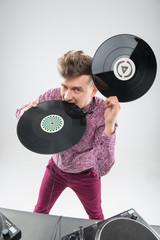 DJ biting vinyl record