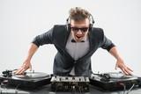 Fototapety DJ in tuxedo mixing by turntable