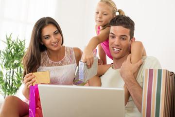 Happy family having online shopping