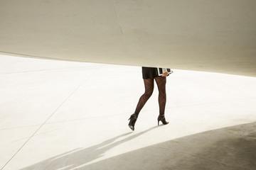 Trendy modern businesswoman legs walking