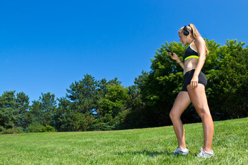 Fit woman listening to music during a workout