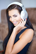 Happy young woman listening to music