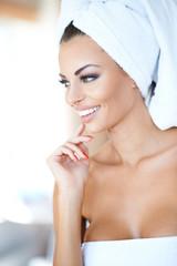 Beautiful young woman enjoying a spa treatment
