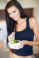 Healthy woman eating a fresh mixed salad