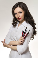 Beauty salon makeup artist with brushes
