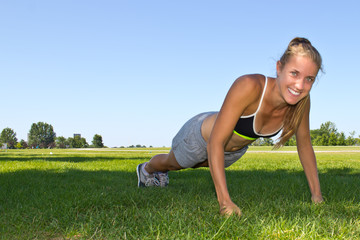 Fit, athletic woman doing push ups