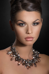 Beauty portrait of woman in necklace