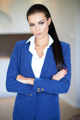 Beautiful businesswoman standing with folded arms