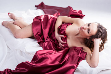 Beauty glamour woman lying in bed