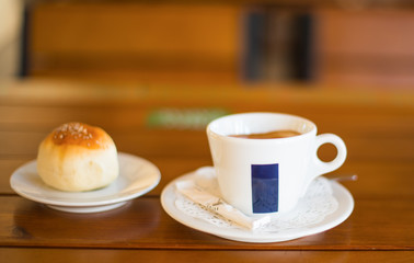 Coffee Cup and Bread Roll. Continental Breakfast.