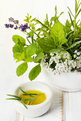 Fresh rosemary with olive oil and bouquet of herbs