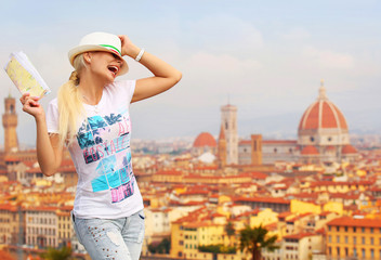 Happy Tourist in Florence. Cheerful Young Blonde Woman with Map