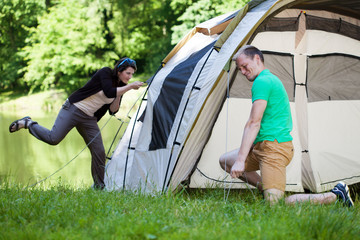 Couple trying to pitch a tent