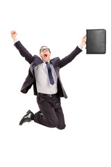 Delighted businessman jumping out of joy